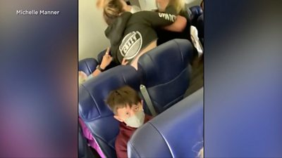 Footage shows US flight attendant being attacked by passenger